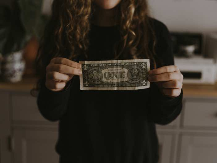 Girl holding dollar